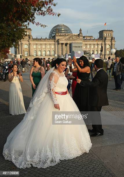 Turkish wedding party makes a stop to play music and dance briefly near the Reichstag on the 25th anniversary of German reunification on October 3...