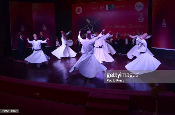 Turkish Whirling Dervish dancers perform in connection with 70 years of PakTurk Diplomatic Relations at Alhamra hall in Lahore
