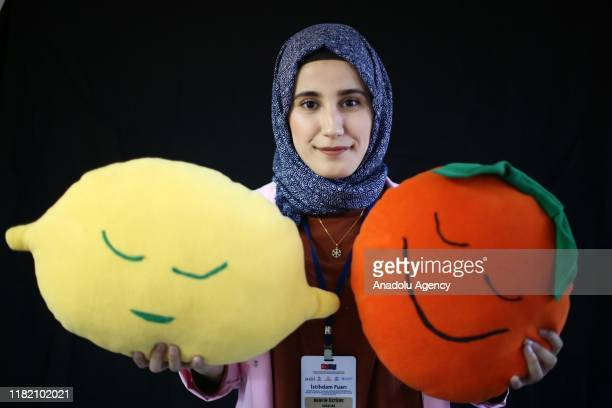 Turkish woman Berfin Ozturk holds handiworks made in a course on art works handcrafts and souvenir production within a cooperative project named...
