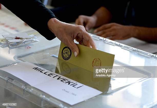 Turkish woman casts her ballot in the 26th general election at a polling Station in Izmir Turkey on November 01 2015 More than 54 million Turkish...