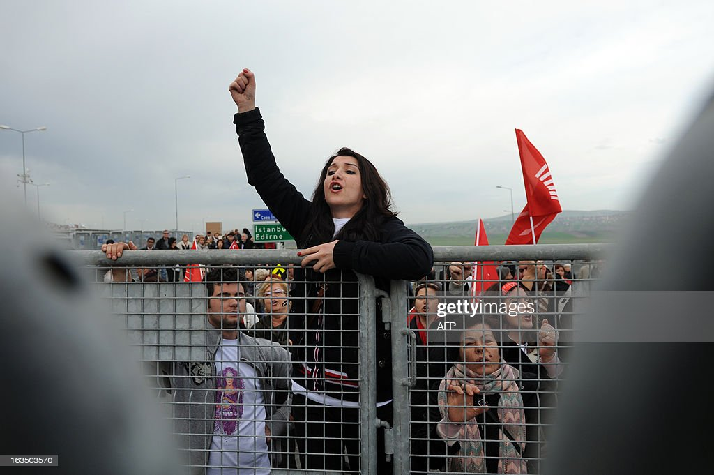 A Turkish woman chants slogans to protest in front of gendarmerie barricades in Silivri near Istanbul on March 11, 2013 where prosecutors are scheduled to deliver their final arguments in the case against 275 people accused of plotting to overturn the Islamic-leaning government. A verdict in the four-year long case involving 275 defendants, including Turkey's former military chief Ilker Basbug and other army officers as well as lawyers, academics and journalists, is expected in the coming weeks. The defendants face dozens of charges, ranging from membership in an underground 'terrorist organisation' known as Ergenekon and instigating an armed uprising against Erdogan and his Justice and Development Party (AKP), which came to power in 2002.
