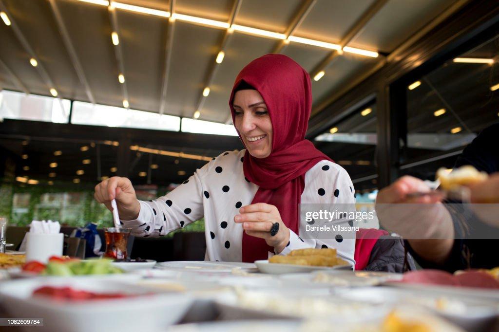 Turkish woman eating breakfast : Stock Photo