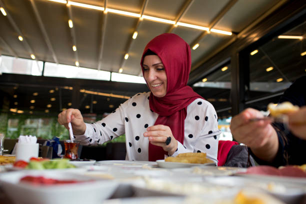 Turkish woman eating breakfast