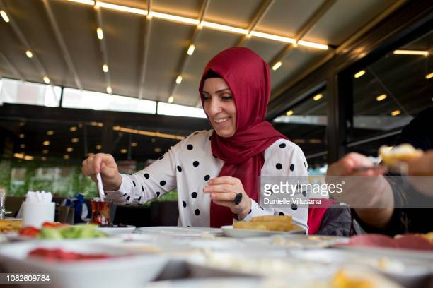 Turkish woman eating breakfast