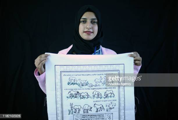 Turkish woman Hatun Kurt holds handiworks made in a course on art works handcrafts and souvenir production within a cooperative project named Ekmek...
