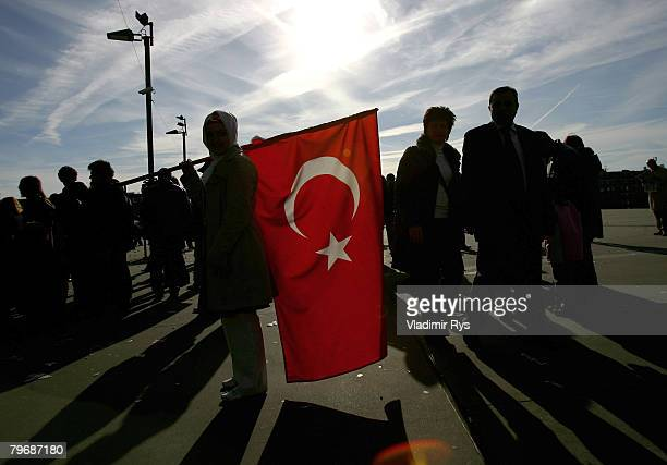Turkish woman holds a flag in front of the KoelnArena prior to speach of the Turkish Prime Minister Recep Tayyip Erdogan at the KoelnArena to the in...