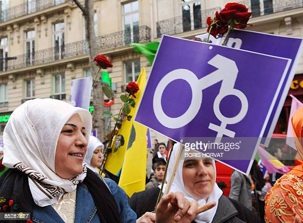 A Turkish woman holds a placard during a demonstration on March 7 2009 in Paris on the eve of the International Women's Day Conceived in 1910 and...