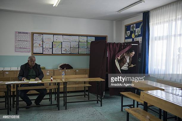 Turkish woman leaves the polling booth during the 26th general election at a polling station in Ankara Turkey on November 01 2015 More than 54...