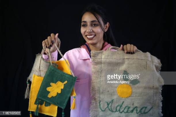 Turkish woman Nazli Ertem holds handiworks made in a course on art works handcrafts and souvenir production within a cooperative project named Ekmek...