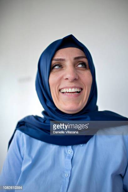 Turkish woman poses for a portrait in her home