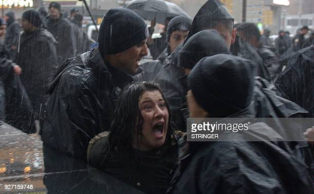 TOPSHOT Turkish woman shouts at Turkish riot police as they try to detain her during a rally for Women's rights in Ankara on March 4 2018 / AFP PHOTO...