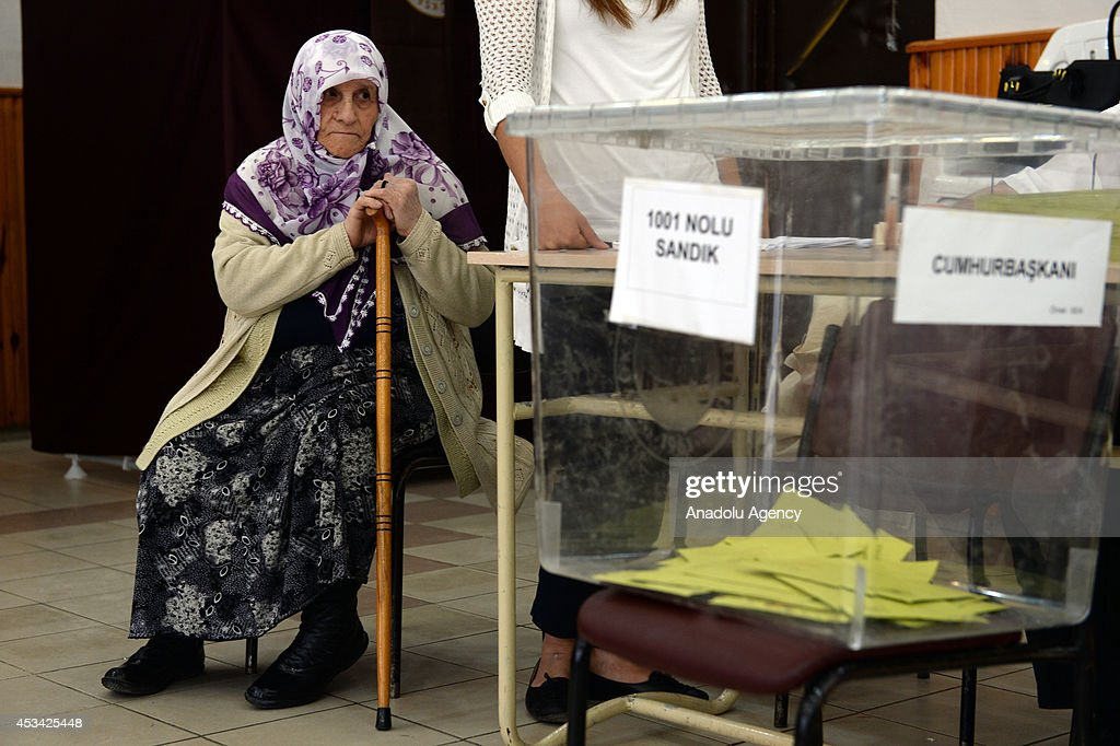 A Turkish woman sits on a chair as she waits to cast her ballot in the Turkey's presidential election at a polling station in Bayburt, Turkey on August 10, 2014. Millions of Turkish voters go to the polls Sunday for an election in which for the first time the president will be elected by popular vote.