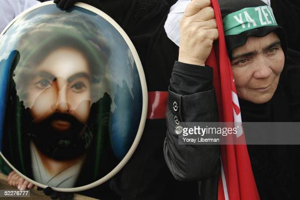 Turkish woman weeps near a painting of Imam Hussein during the Shia holy day Ashura February 20 2005 in Istanbul Turkey Ashura is a Shia Muslim holy...