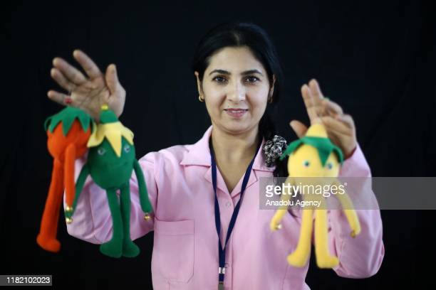 Turkish woman Yasemin Altun holds handiworks made in a course on art works handcrafts and souvenir production within a cooperative project named...