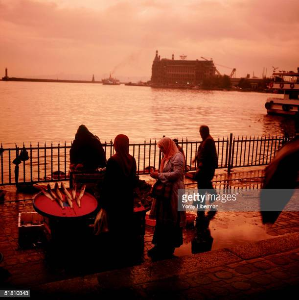Turkish women buy fish for the Iftar meal Ramadan end of daily fasting near Kadikoy ferry station on the Asian side of Istanbul October 14 2004 in...