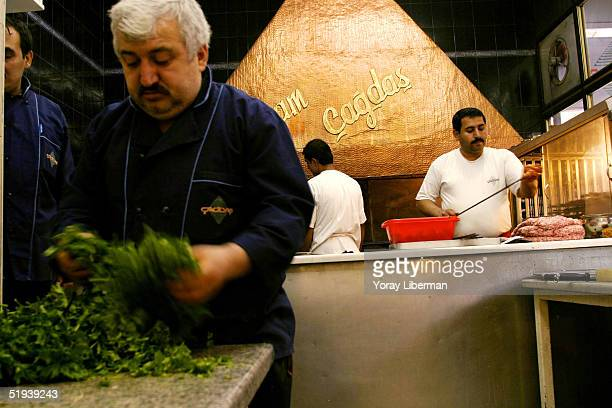 Turkish workers prepare Kebabs in Imam Cagdas restaurant and baklava production house one of the most prestigious restaurants and baklava producers...
