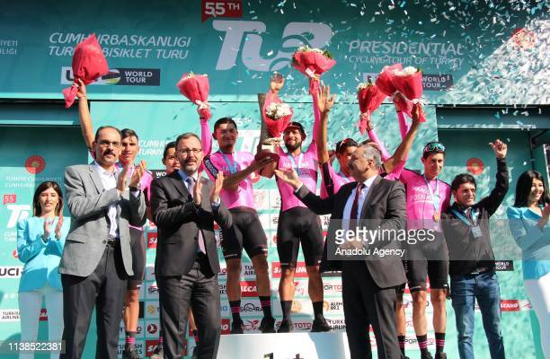 Turkish Youth and Sports Minister Mehmet Muharrem Kasapoglu gives the trophy to the 55th Presidential Cycling Tour of Turkey winner Manzana Postobon...