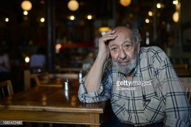 Turkish-Armenian photographer Ara Guler poses at Ara Cafe on July 7, 2015 in Istanbul. - Legendary photographer Ara Guler, famed for iconic images of...