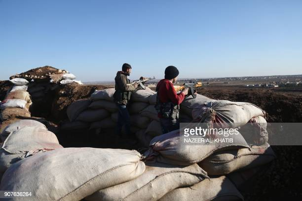 TOPSHOT Turkishbacked fighters from the Free Syrian Army hold a position in the Tal Malid area north of Aleppo as they prepare to target Kurdish...