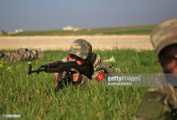 TOPSHOT Turkishbacked fighters take part in a training at a military barracks north of the Syrian town of Manbij on March 6 2019
