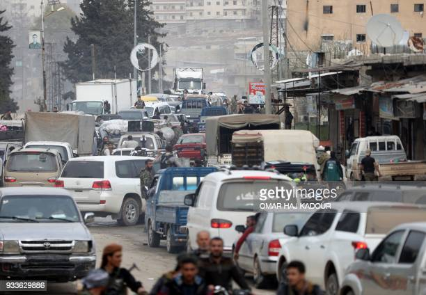 Turkishbacked Syrian Arab fighters drive in the Kurdishmajority city of Afrin in northwestern Syria after seizing control of it from the Kurdish...