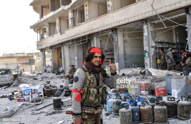 Turkishbacked Syrian Arab fighters loot shops after seizing control of the northwestern Syrian city of Afrin from the Kurdish People's Protection...