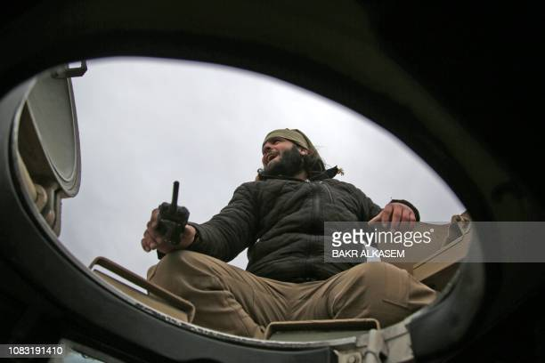 Turkishbacked Syrian fighter sits atop an armoured vehicle as he participates in a training manuever near the town of Tal Hajar in Aleppo's province...