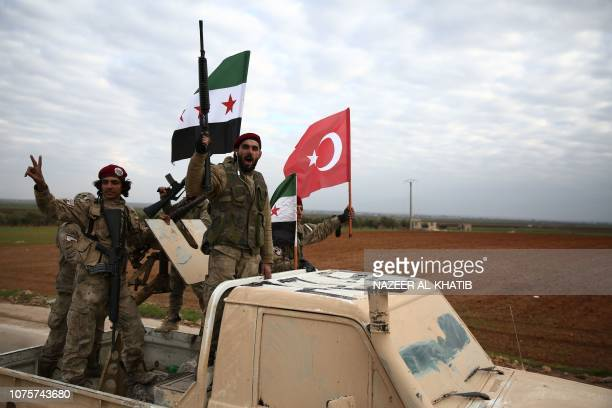 Turkishbacked Syrian fighters gather during a military training in the north of Aleppo province in preparation to be deployed in the outskirts of...