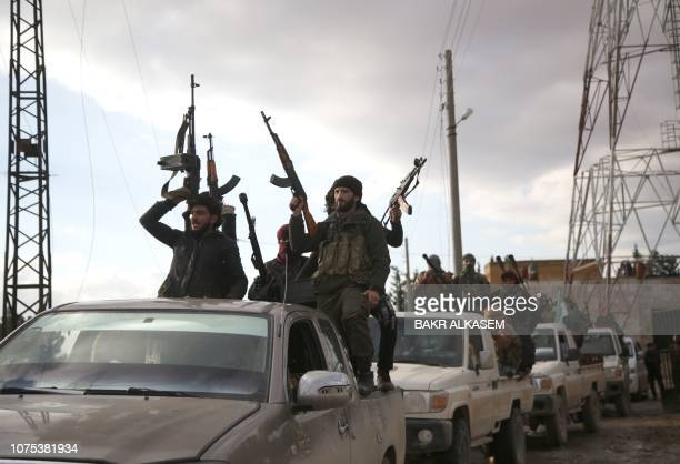 TOPSHOT Turkishbacked Syrian fighters gather in the area of Sajour between the northern Syrian towns of Jarables and Manbij on December 28 2018