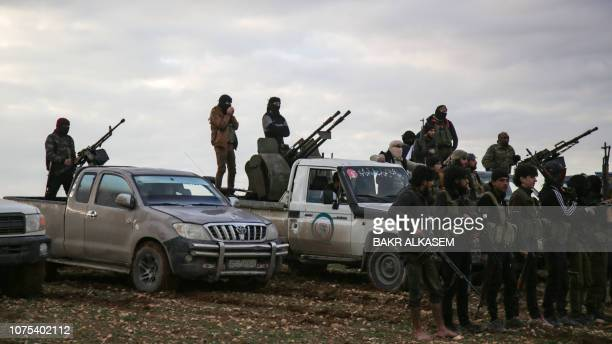 Turkishbacked Syrian fighters gather with their vehicles at a position near the northern Syrian town of Manbij on December 28 2018