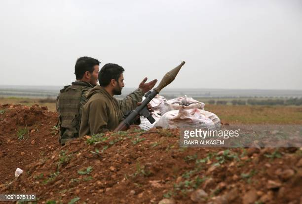 Turkishbacked Syrian fighters keep position near the town of Tal Hajar in Syria's northern Aleppo province a few kilometres from areas controlled by...