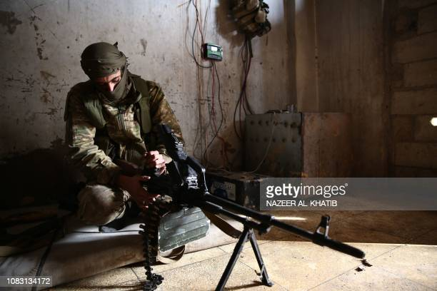 Turkishbacked Syrian opposition fighter rests in a building near the village of Hamran northwest of the northern Syrian town of Manbij on January 15...