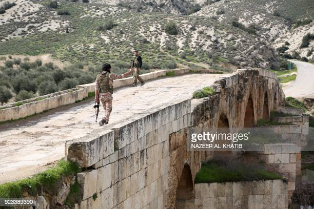 Turkishbacked Syrian opposition fighters walk on the Roman bridge in the archaeological site of Cyrrhus or Nabi Huri northeast of the Syrian city of...