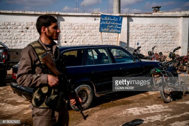 A Turkishbacked Syrian rebel fighter patrols in a street during a demonstration in support to Turkish army's Olive Branch operation in the Syrian...