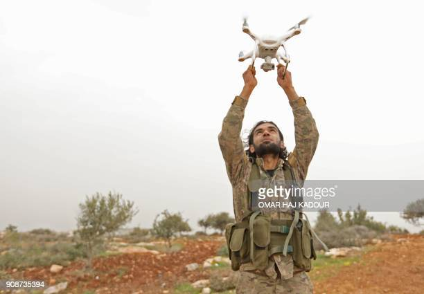 Turkishbacked Syrian rebel fighter uses a drone at a monitoring point near the Syrian village of Qilah in the southwestern edge of the Afrin region...