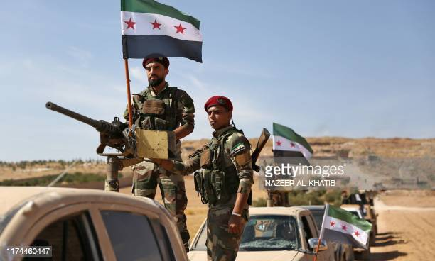 Turkishbacked Syrian rebel fighters head to an area near the SyrianTurkish border north of Aleppo on October 8 2019 US forces in northern Syria...