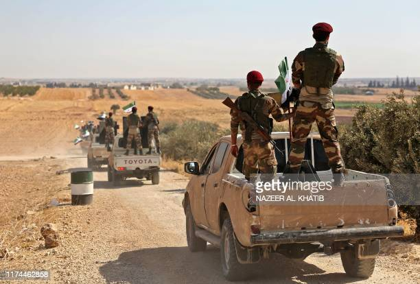 Turkish-backed Syrian rebel fighters head to an area near the Syrian-Turkish border north of Aleppo on October 8, 2019. - US forces in northern Syria...