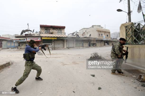 TOPSHOT Turkishbacked Syrian rebels advance during the fight to seize control of the town of Jandairis from Kurdish forces on March 8 2018 in Syria's...
