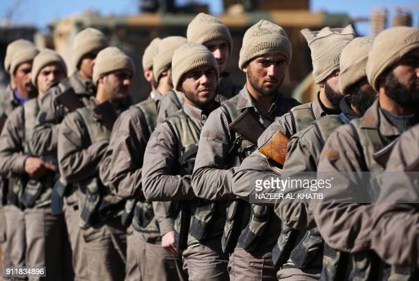 Turkishbacked Syrian rebels march on Mount Barsaya north of Azaz on January 29 as the Turkish offensive against Kurdish forces in the Syrian border...