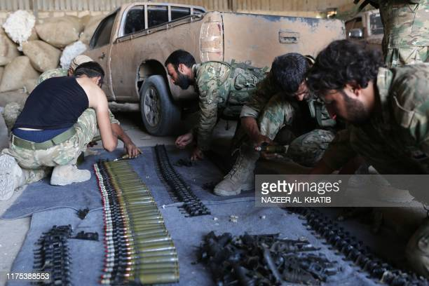 Turkishbacked Syrian rebels restock on ammunition as they gather near the border town of Ras alAin on October 12 as Turkey and its allies continued...