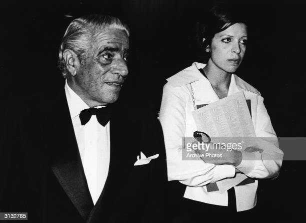 Turkishborn shipping billionaire Aristotle Onassis and his daughter Americanborn shipping heiress Christina Onassis walk to gether as they attend an...