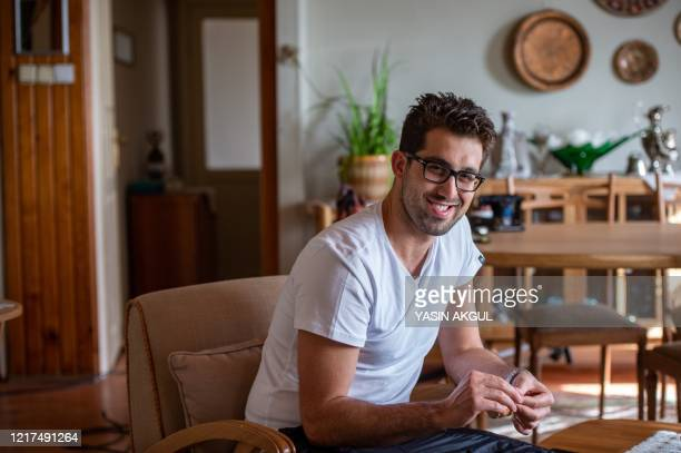 Turkisk actor Dogu Demirkol speaks during an interview with AFP speaks on how TV sets work, in Beykoz, in the outskirts of Istanbul on May 20, 2020....