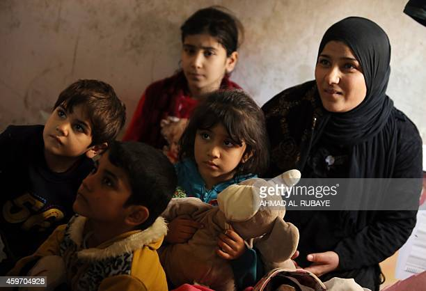 A Turkman family who were displaced from the northern Iraqi city of Mosul after Islamic State group militants took control of the area in June 2014...