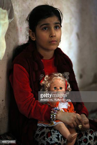 A Turkman girl who was displaced with her family from the northern Iraqi city of Mosul after Islamic State group militants took control of the area...