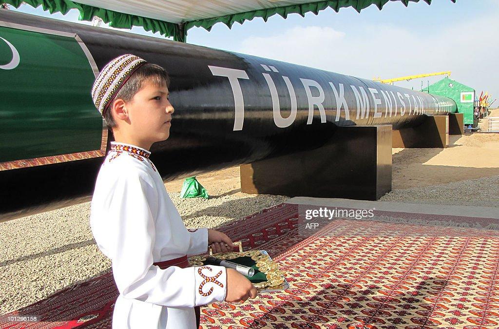 A Turkmen boy in traditional dress waits : News Photo
