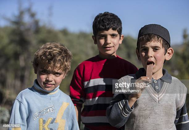 Turkmen children who escaped to the Yamadi camp for a photograph, as Russia and Assad regime forces continue its air attacks on Turkmen town of...