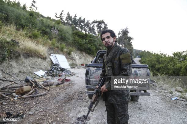 Turkmen commander Izzet Baldir poses for a photograph during an interview at the Turkmen Mountain in Lattakia Syria on July 3 2017 He continues...
