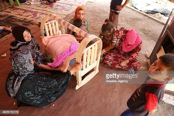 Turkmen families, fled Tal Afar seized by armed groups led by Islamic State of Iraq and the Levant , try to live under difficult conditions in Sinjar...