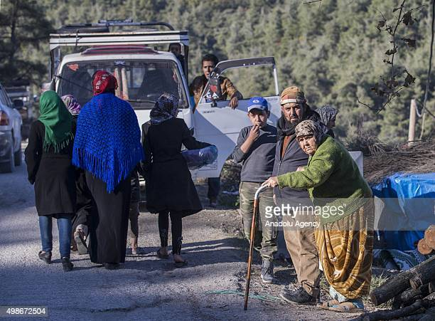 Turkmen families who escaped from Russian and Assad regime forces air attacks on Turkmen town of Bayirbucak in Lattakia, arrive at the Yamadi camp...
