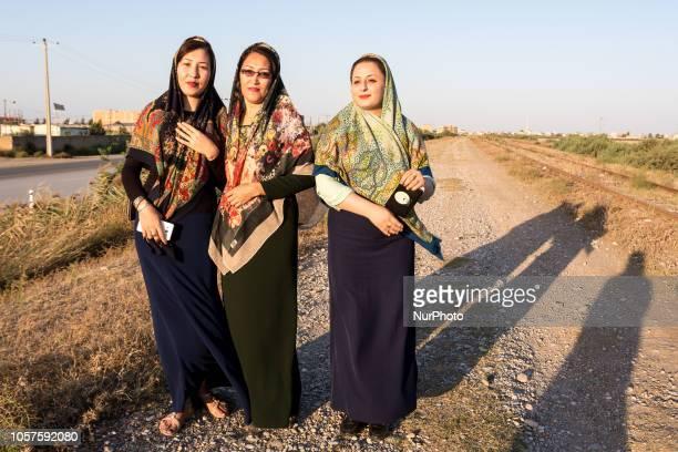 Turkmen Iranian women walk on a path in the evening in Bondar e-Torkman, Golestan Province of Iran on September 29, 2018.